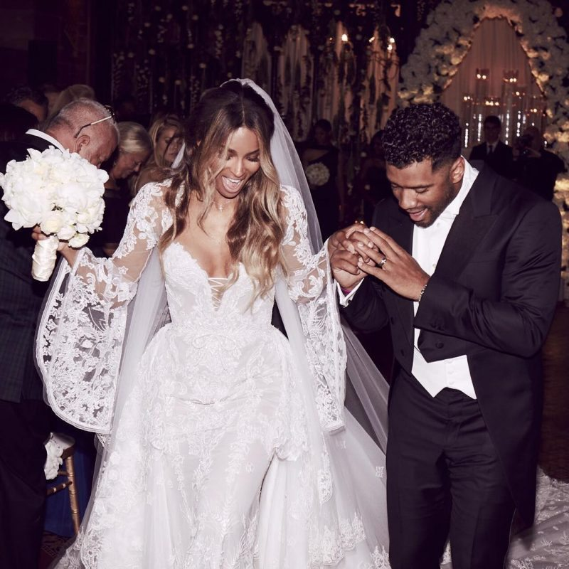 Gorgeous Pair: Russell Wilson holds onto Ciara as she stuns in a Cavalli Couture wedding dress.