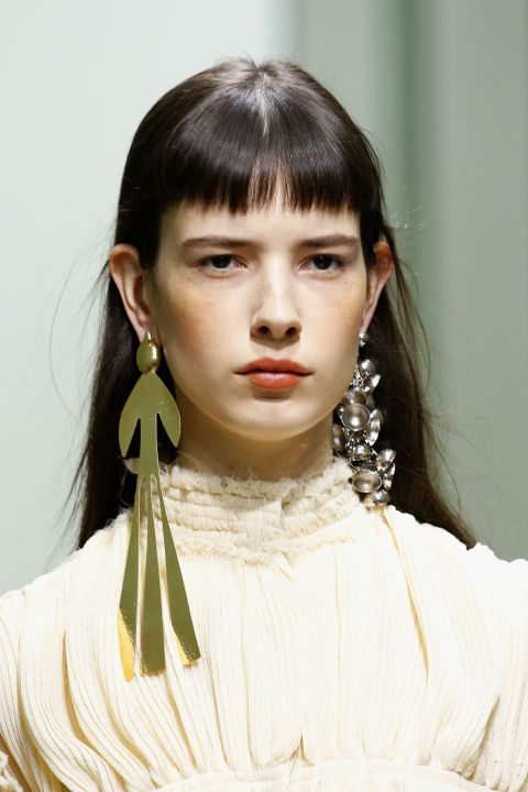 mismatched earrings on model for jwanderson
