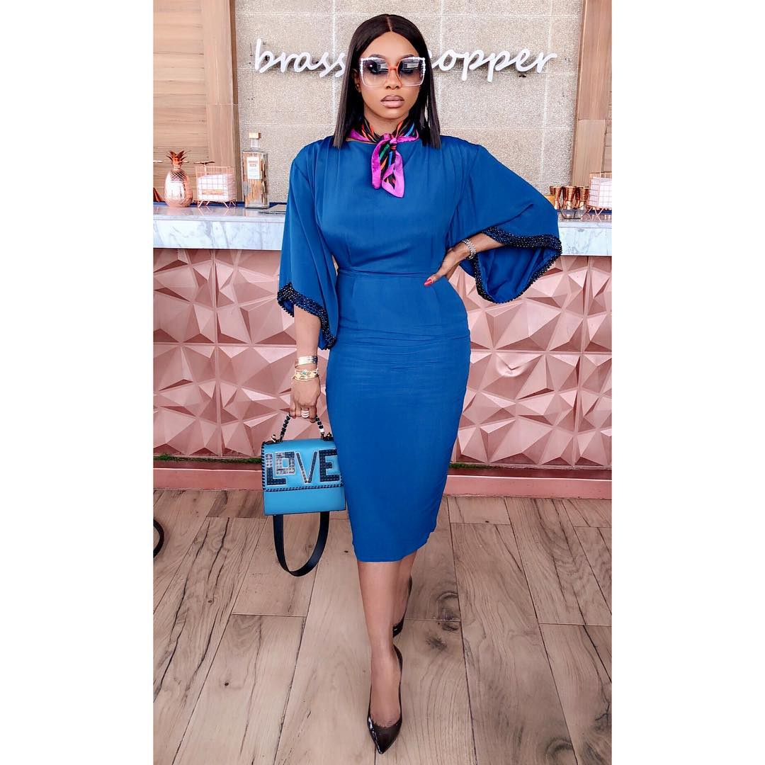 chioma good hair on a navy blue body con dress