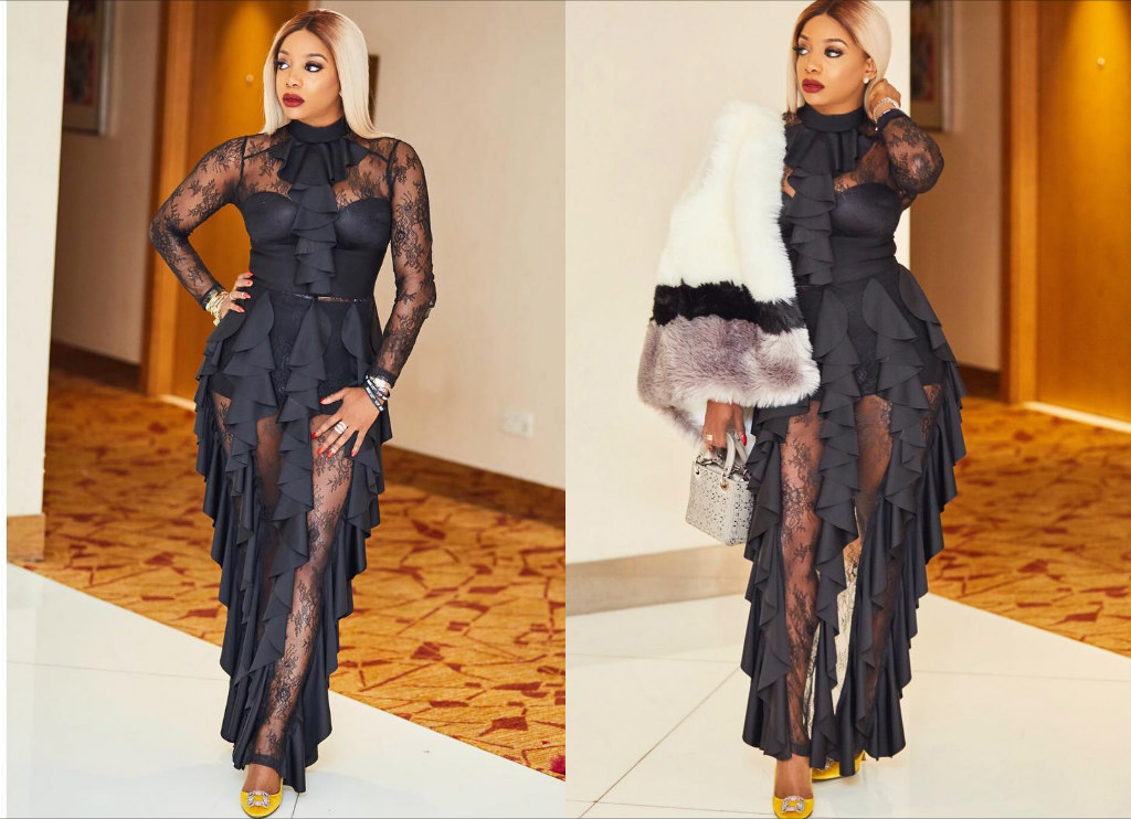 Chioma ikokwu in a black flowering patterned jumpsuit attire
