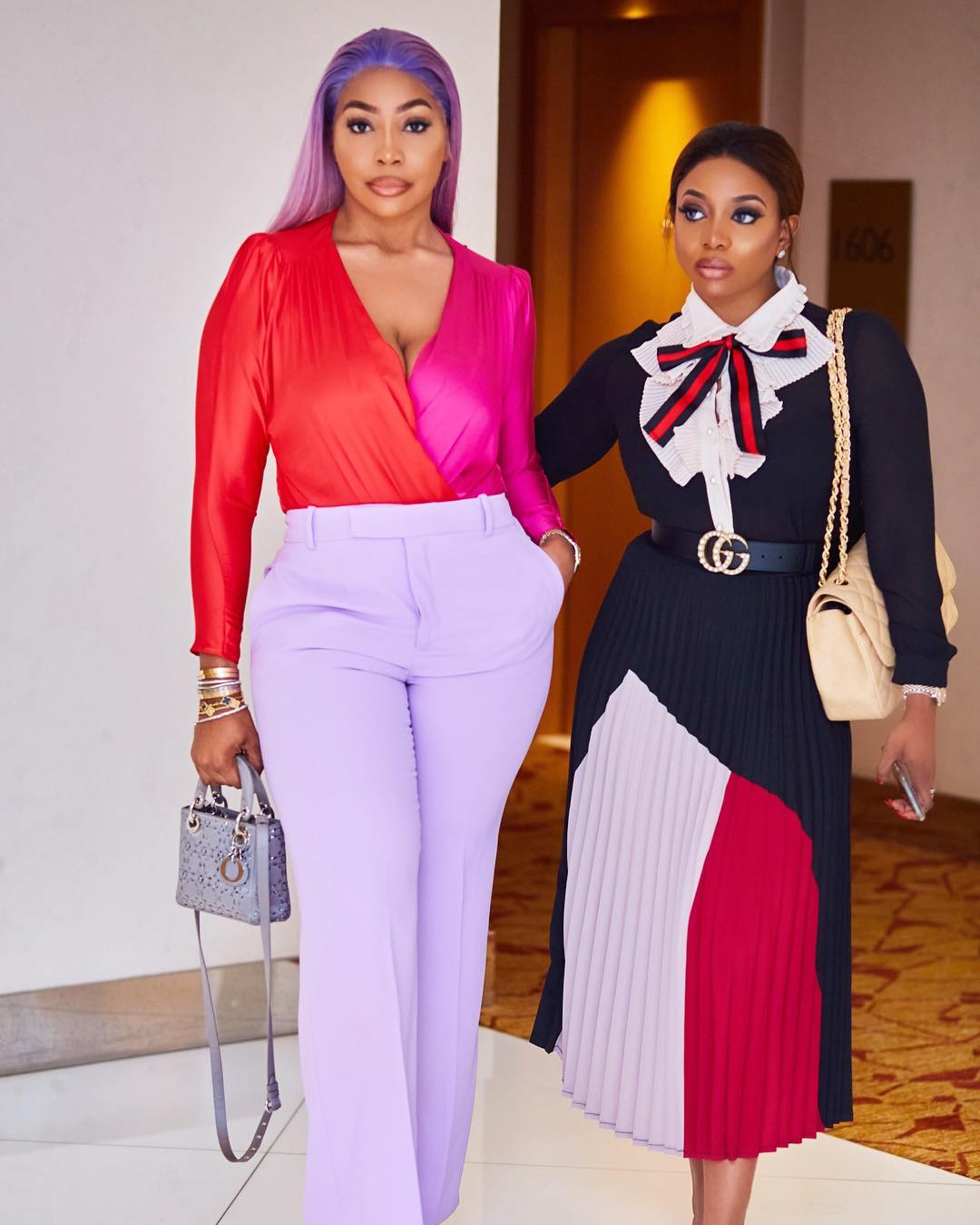 kika good in the 2018  arise fashion week in lovely wine red top and white pants
