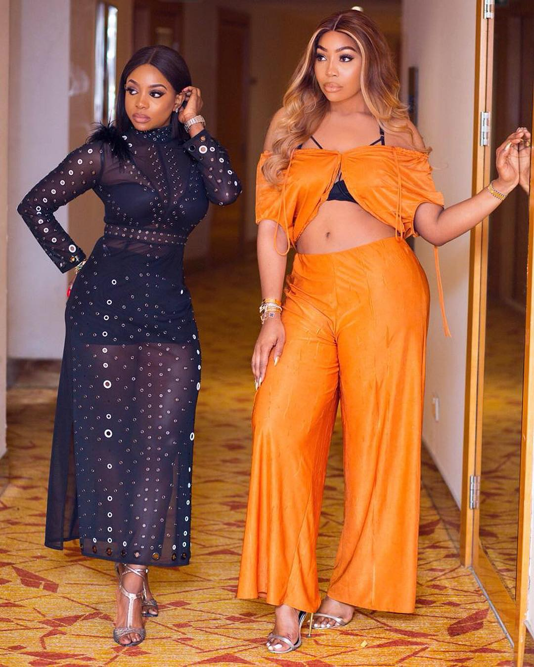 image of kika osunde and chioma ikokwu at the arise fashion week looking lovely in orange and black jumpsuits