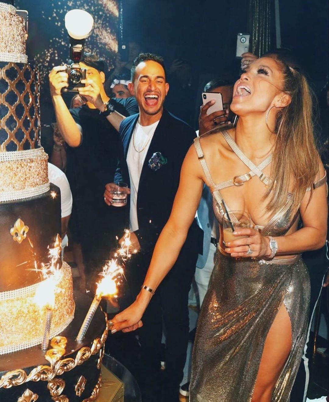 jennifer-lopez-birthday-bash-fashion-style-dresses-gold-50th
