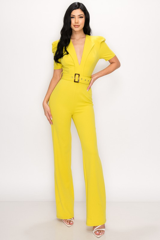 Model wearing jumpsuit with deep V-neck and wide cinched belt with puffed sleeves in various colors and poses.