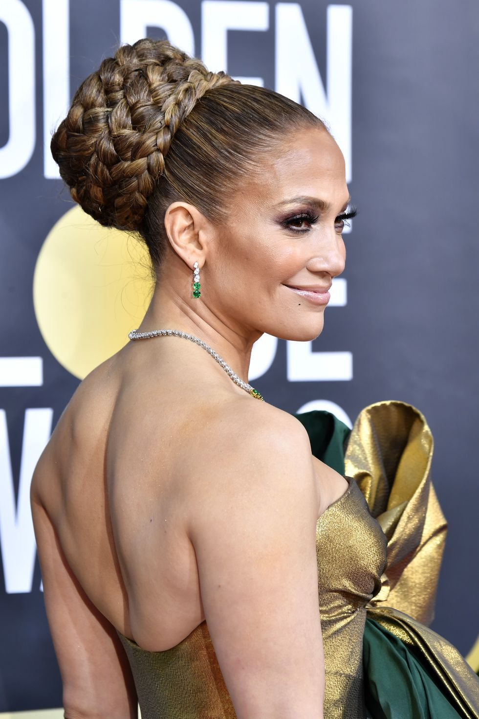 2020-beauty-trends-smokey-eye-look-on-braided-bun-j-lo-lopez