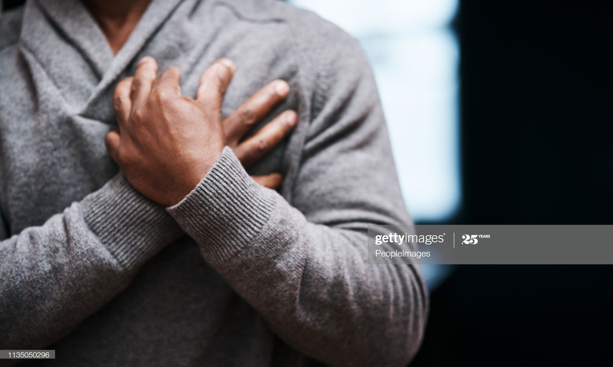 black man touching his chest heart health