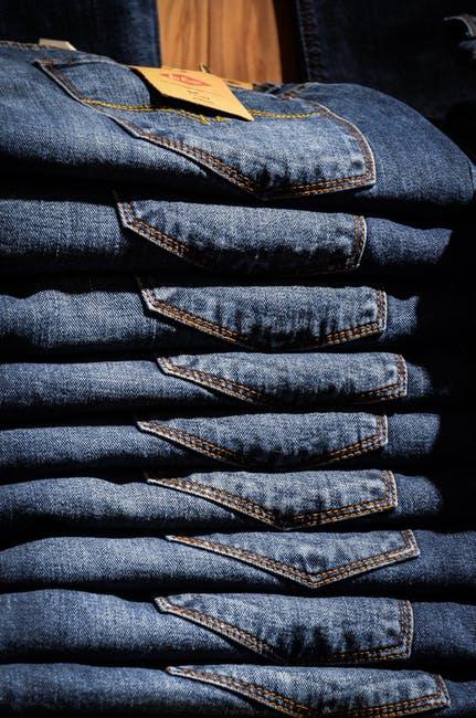 Pile of denim jeans