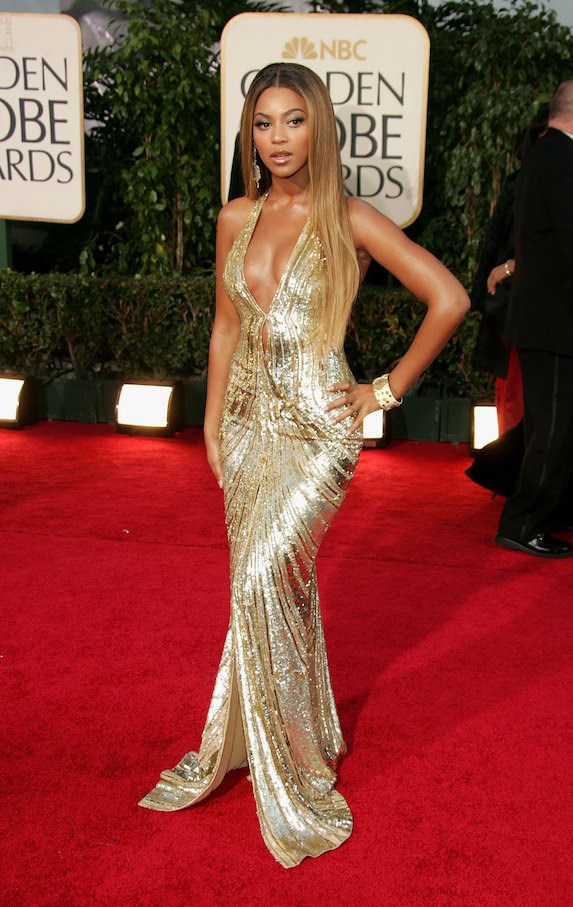gold dress the-evolution-of-beyonce's-style:-from-the-bootylicious-singer-to-the-homecoming-queen