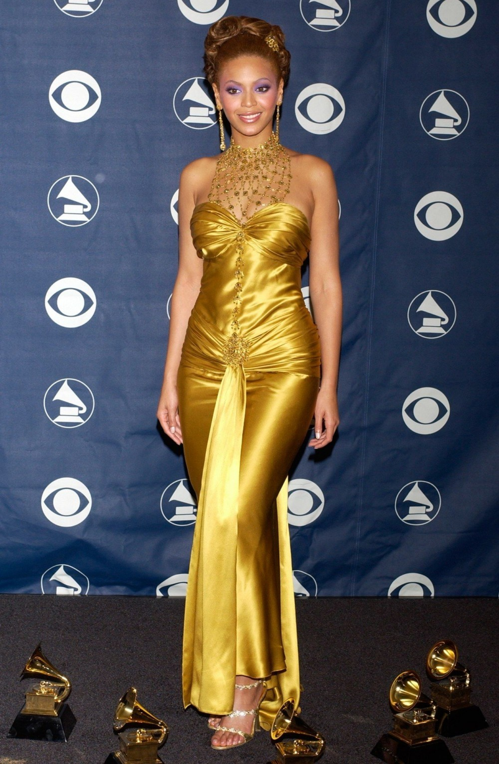 gold dress with bead accessories grammy awards 2004 the-evolution-of-beyonce's-style:-from-the-bootylicious-singer-to-the-homecoming-queen