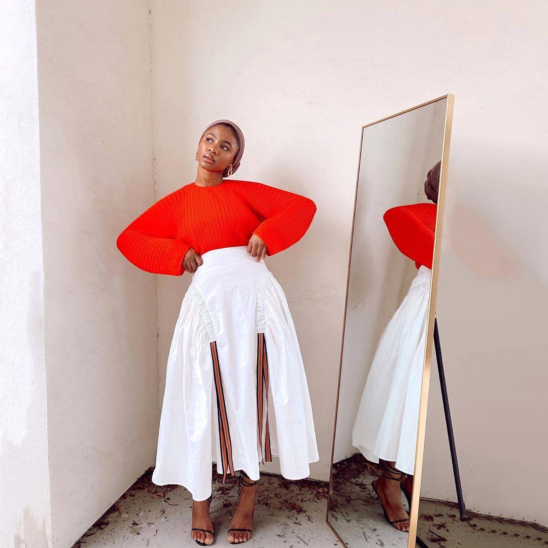 Hafsah Mohammed white skirt red long sleeve top