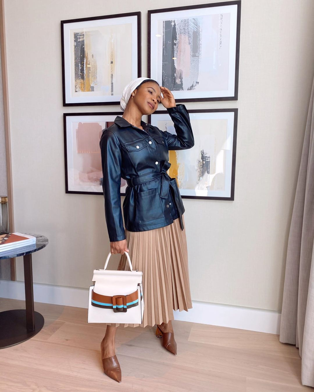 Hafsah Hafymo Mohammed leather jacket How to Style The Midi Skirt Like A Certified Style Raven