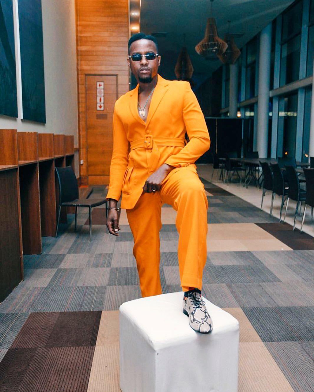 man wearing orange suit
