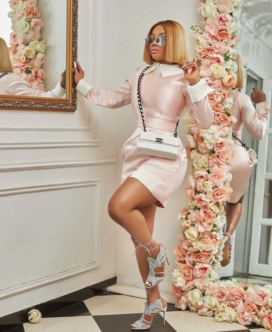 Toke Makinwa pink dress white Chanel bag Black Celebrity Style