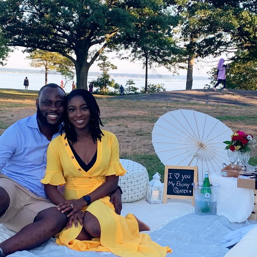 a beautiful black couple on beach picnic date valentine's day date ideas style
