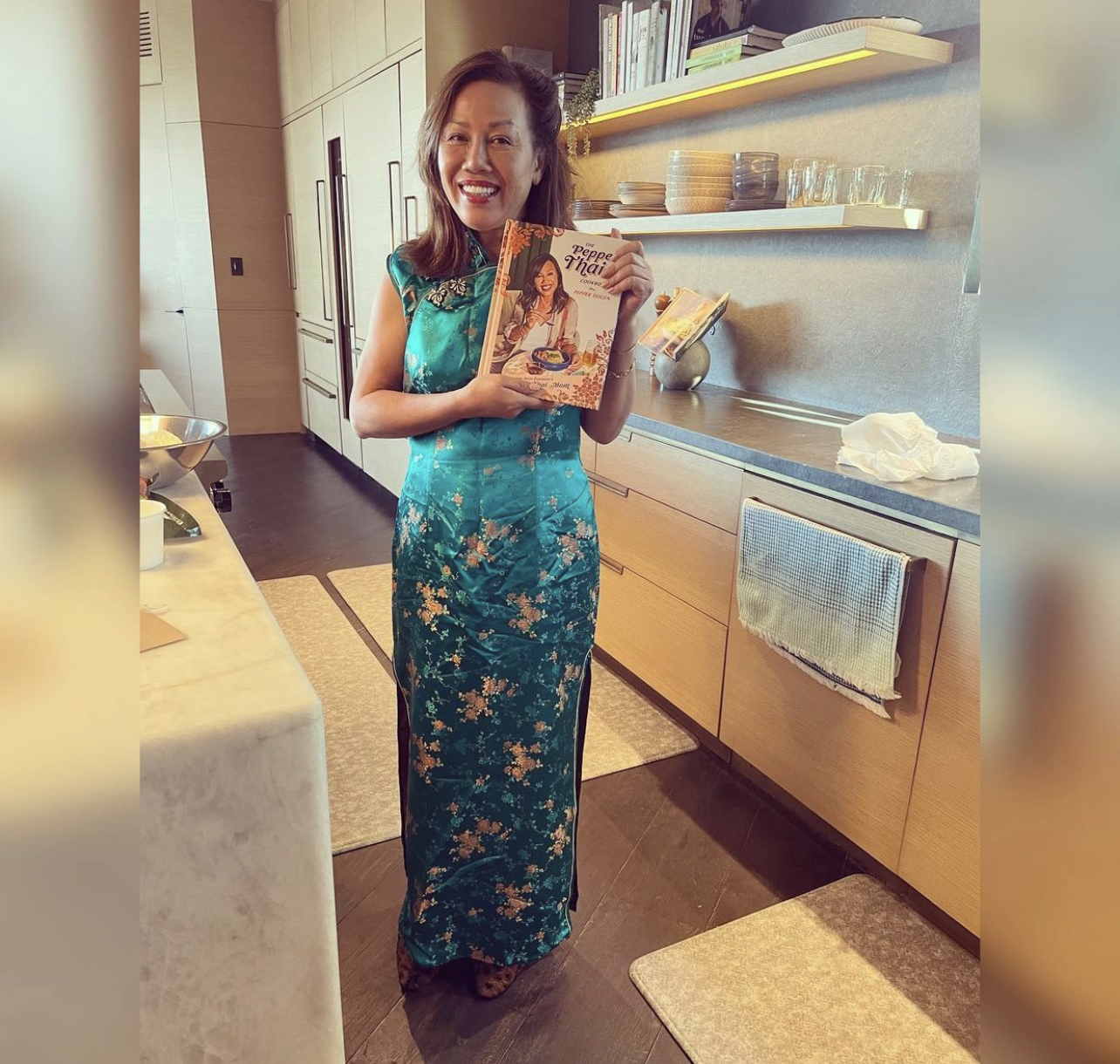pepper vilailuck teigen shows off her cooking book The Pepper Thai Cookbook: Family Recipes From Everyone's Favorite Thai Mom