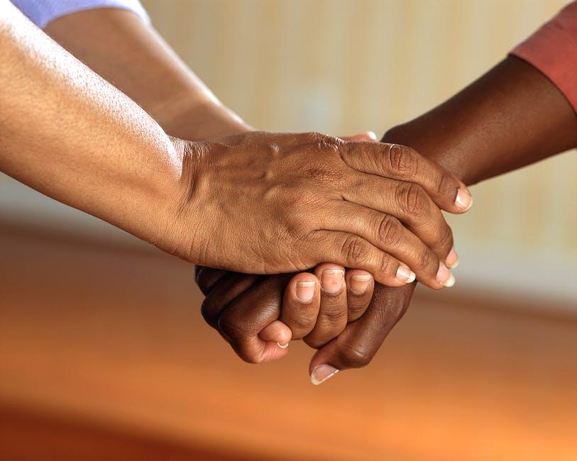 Black couple holding hands relationship